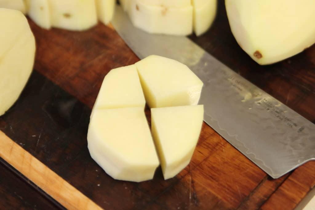 Cut each potato slice into four cubes