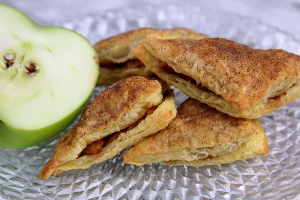 Puff pastry apple pie bites coated in cinnamon sugar.