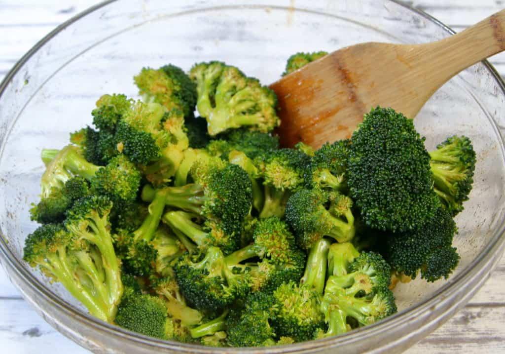 Broccoli florets coated with honey sriracha mixture