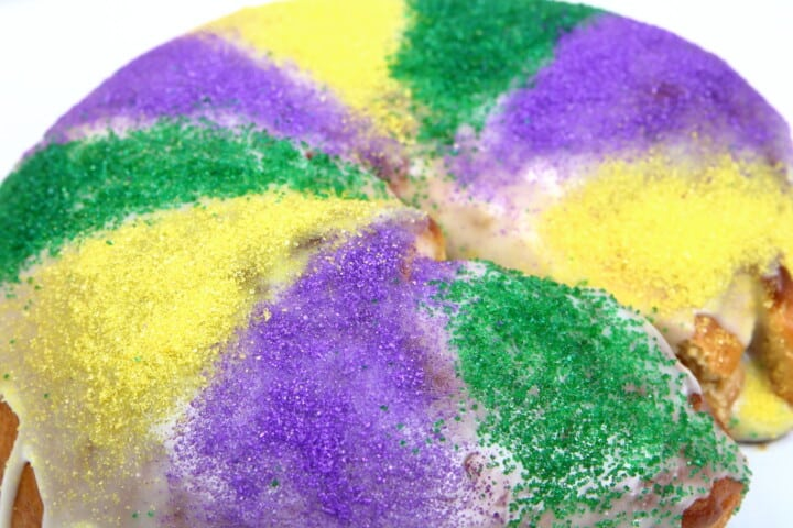 Mardi Gras King Cake with icing and sugar sprinkles