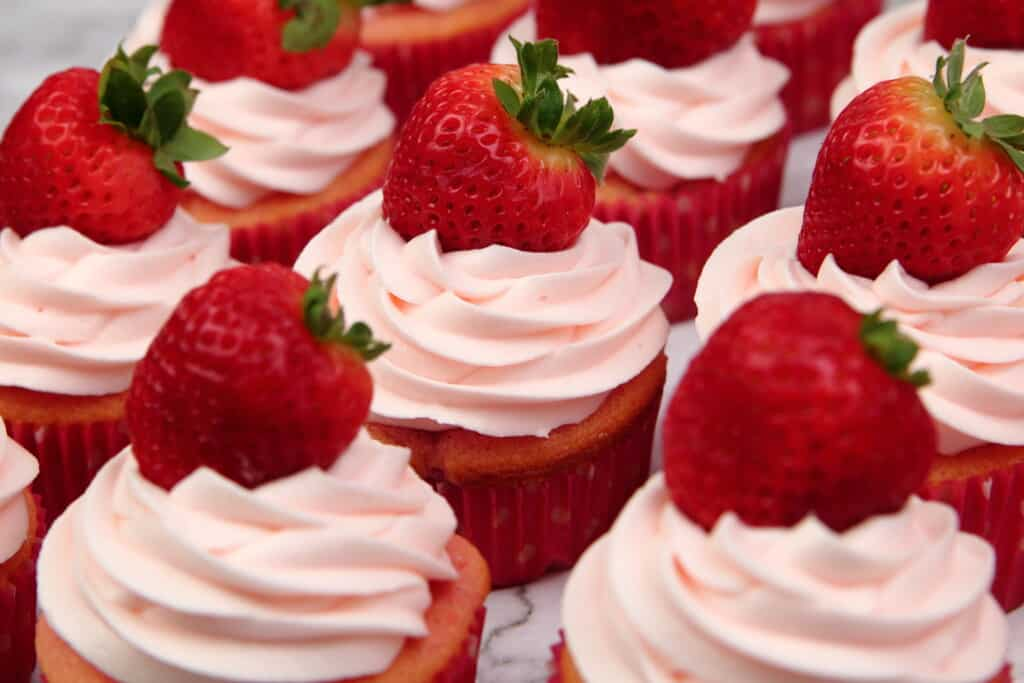 Strawberries and Cream cupcakes with fresh strawberries on top