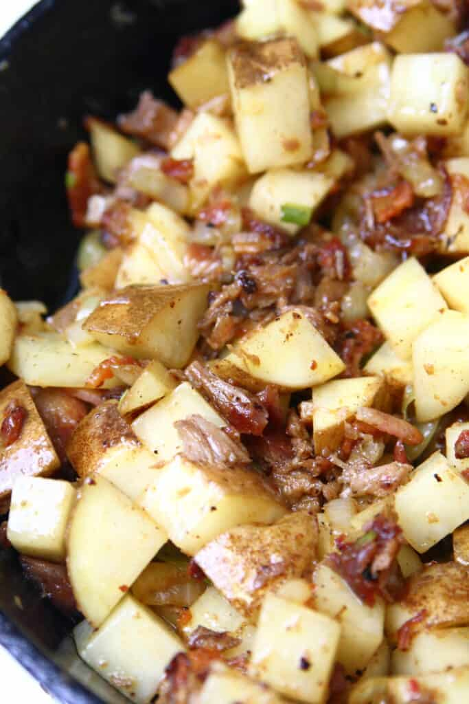 Skillet of potatoes, rib meat, and onions.