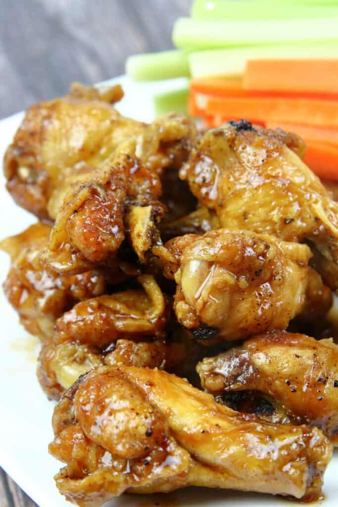 Chicken Drumettes glazed in wing sauce with carrots and celery