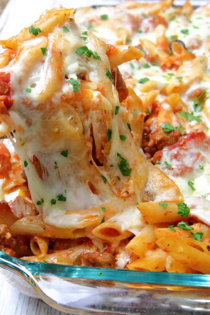 Pizza pasta bake with stringy mozzarella cheese