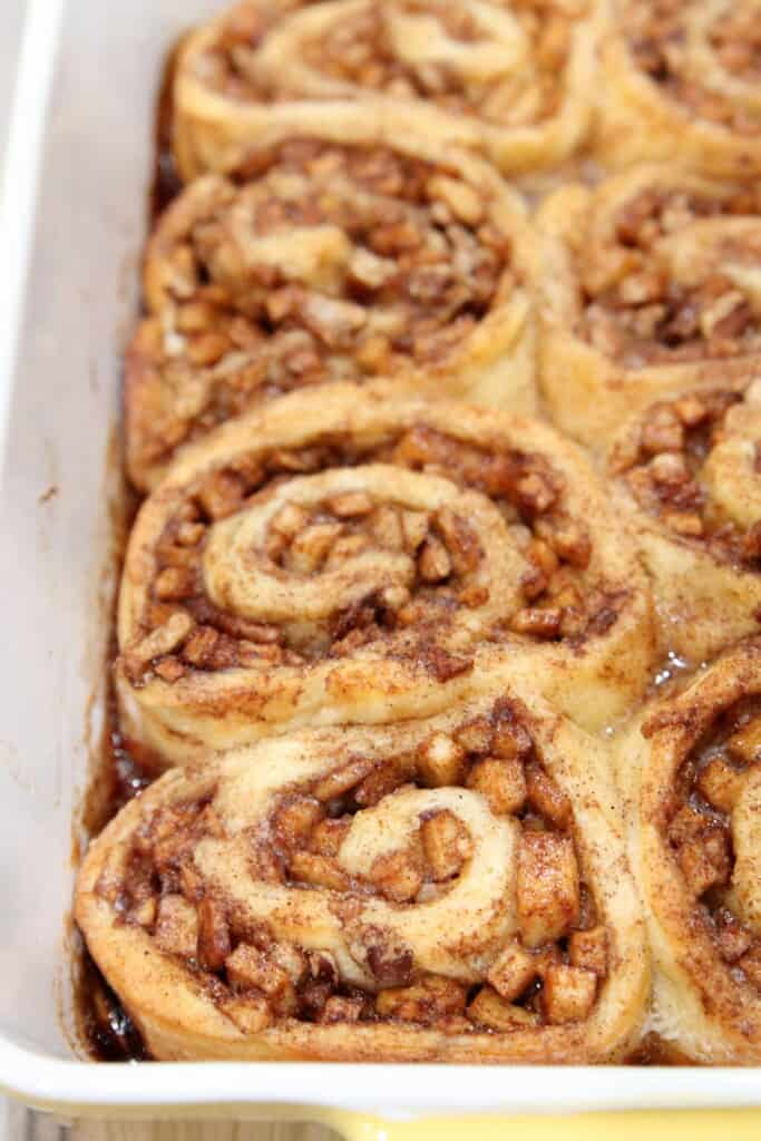 Closeup of a pan of baked apple pie cinnamon rolls