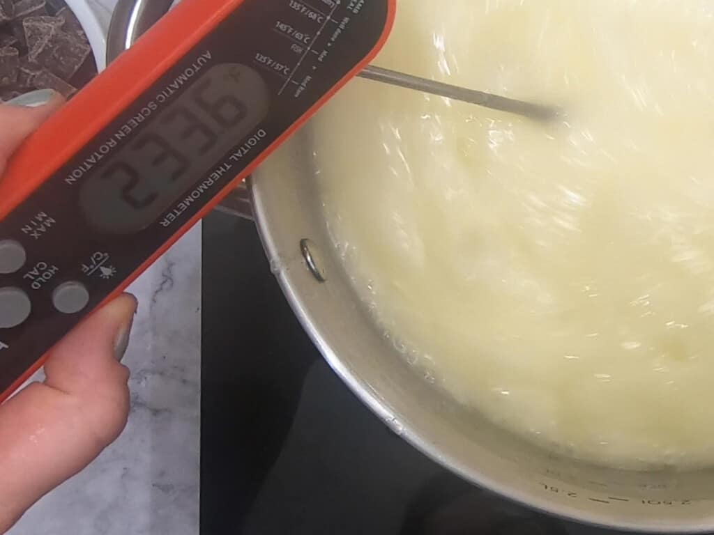 thermometer in a heated pan of butter reading 233.6F
