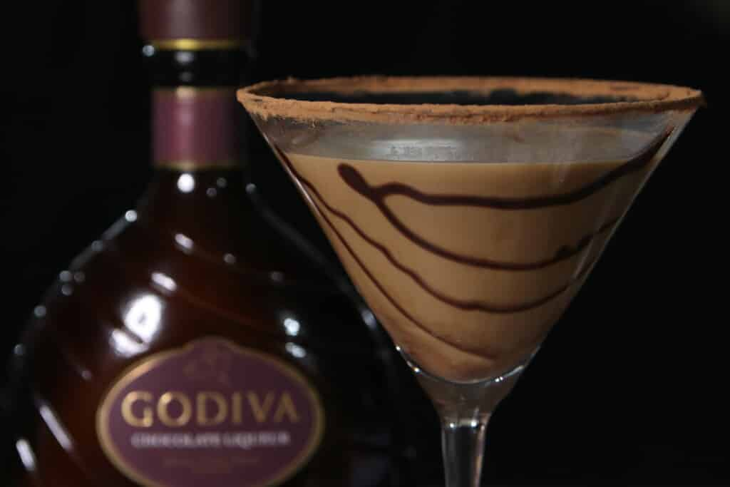 chocolate martini with a bottle of chocolate liqueur