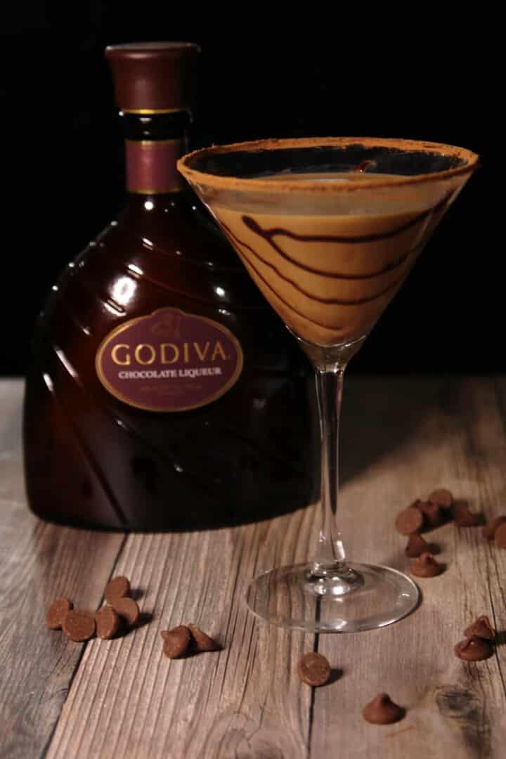 chocolate martini in a glass next to godiva liqueur
