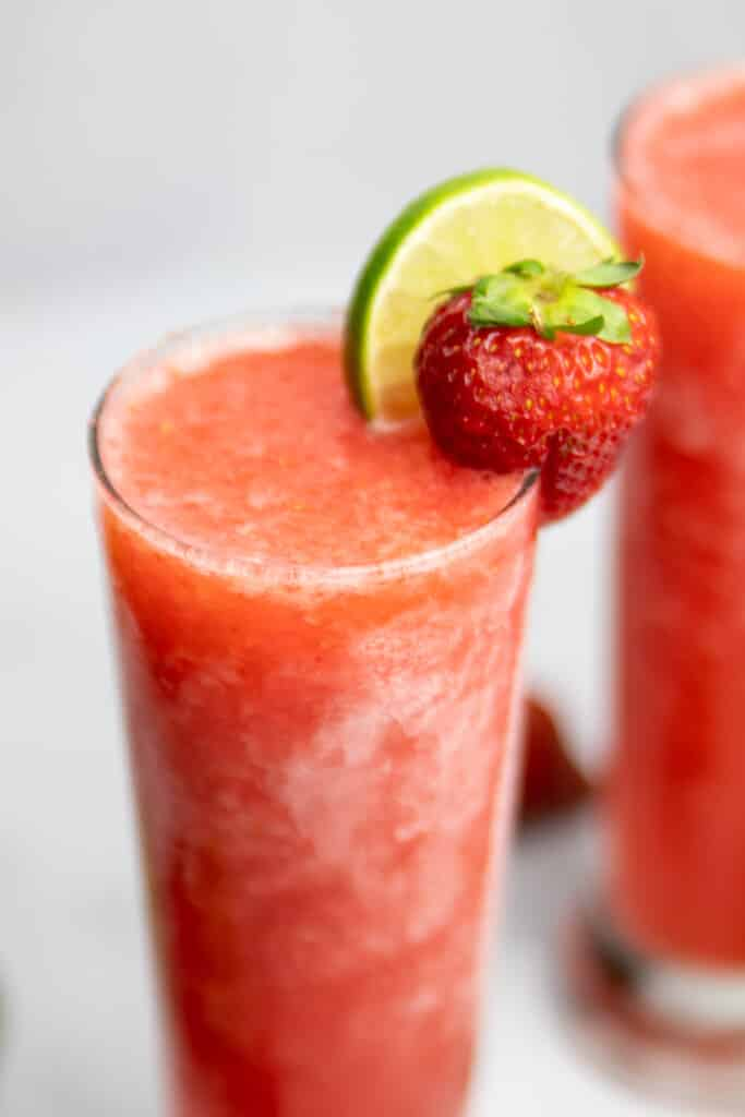 closeup of Frozen Strawberry Limeade Vodka slush with a second one in the background