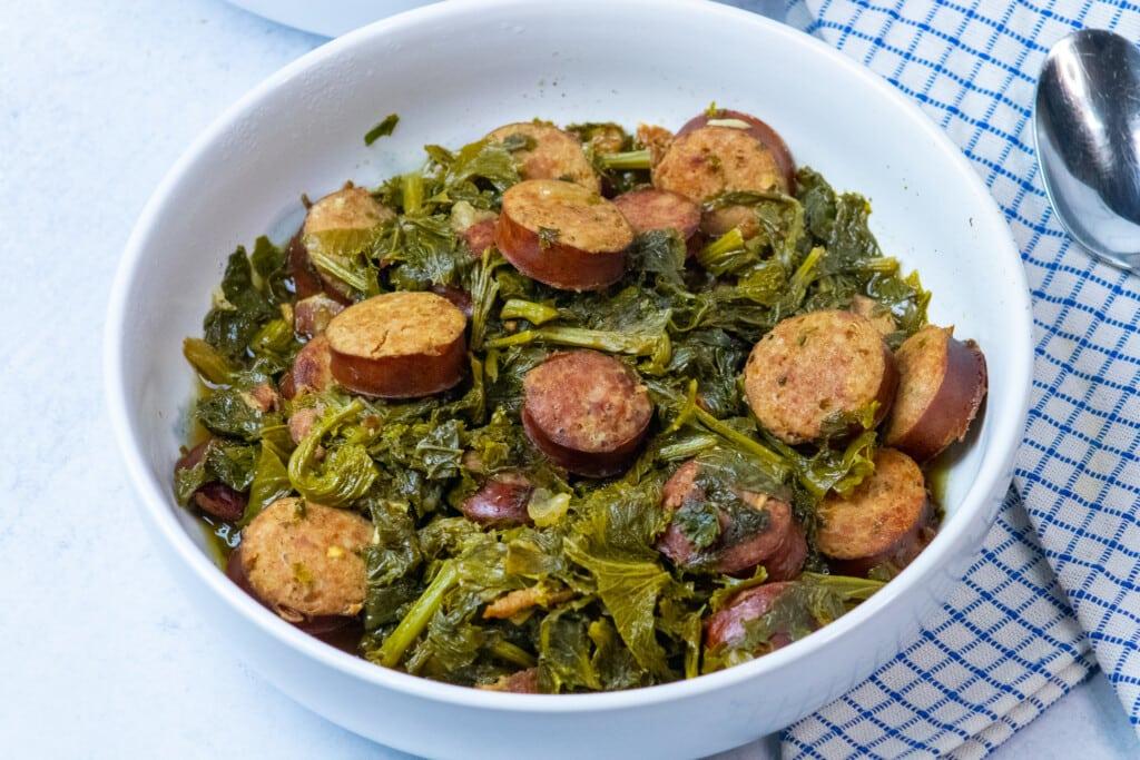 bowl of mustard greens and sausage.
